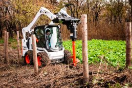 s590-skid-steer-loader-with-a-35hp-planetary-auger_14135184921_o